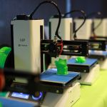 multiple 3d printers lined up