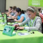 girl coding at laptop with microbit
